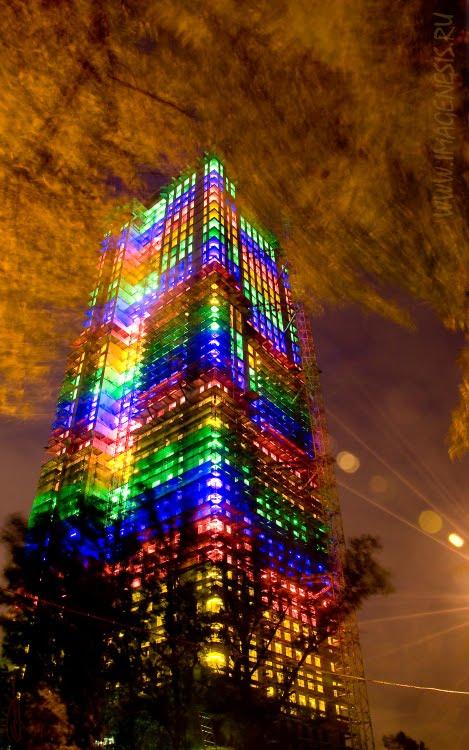 tower wrapped in neon lights burning sky башня в неоновых огнях пылающее небо автор Демидов Игорь