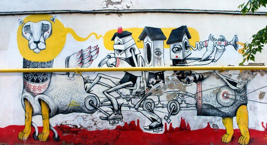 граффити лев механический скворечники едут как на велосипеде автор фото Демидов Игорь bicycle lion mechanical creature Moscow wall