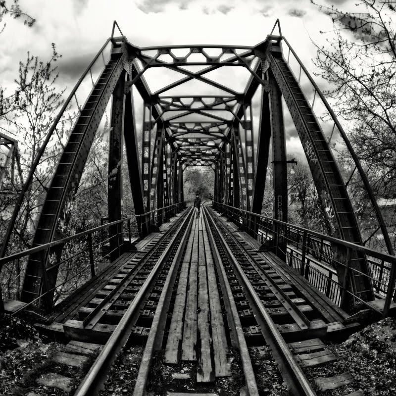 Man walking across railway bridge мужчина пересекающий железнодорожный мост автор Демидов Игорь