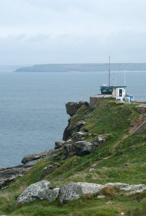 small house above the sea cliffs green grass маленький домик на зелёных скалах над морем автор Демидов Игорь