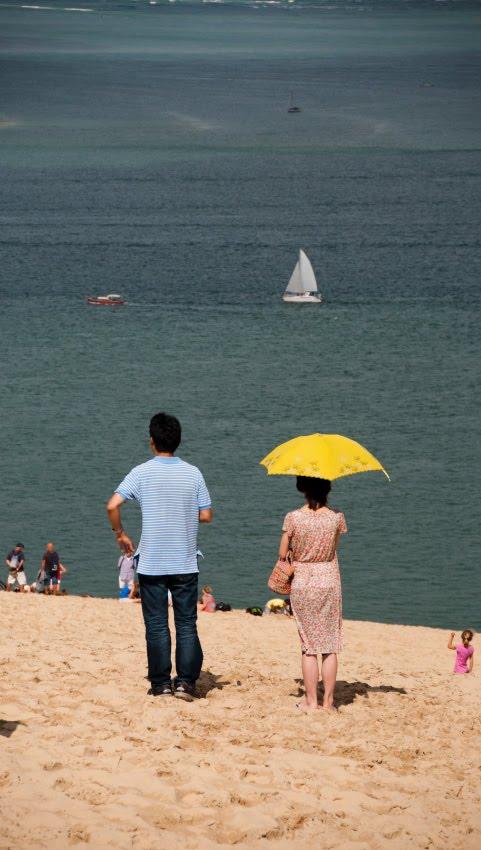 yellow ambrella and small white sail dune pyla желтый зонтик и белый маленький парус вид с дюны Пила автор Демидов Игорь