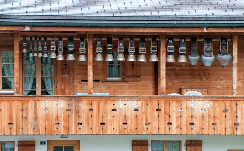 bells for cows on a wooden porch колокольчики и колокола для альпийских коров на деревянном крыльце автор Демидов Игорь